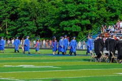 Graduates are walking the line to get a diploma royalty free stock photo