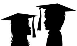 Graduates young man and woman Stock Images