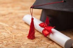 Graduatie GLB en diploma royalty-vrije stock afbeelding