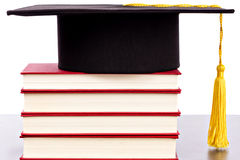 Graduatiehoed en boeken Stock Foto