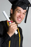 Graduating Man. Graduating college man holding diploma Stock Photos