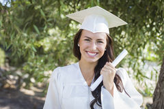 Graduating Mixed Race Girl In Cap and Gown with Diploma Stock Photos