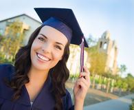 Graduating Mixed Race Woman In Cap and Gown Royalty Free Stock Photography