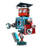 Graduating Robot in grad hat with book. Isolated. Contains clipping path Stock Photo