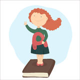 Graduating from school or college. The girl with red hair standing on book, holding school-deserved praise. Another hand shows the sign V - victory Stock Images