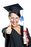 Graduating student with the certificate thumbs up. Graduating student with the certificate and in the black academic gown thumbs up, isolated on white royalty free stock photos