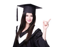 Graduating student finger pointing to copy space Royalty Free Stock Photography