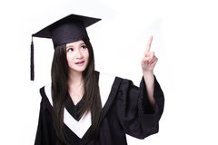 Graduating student finger pointing to copy space Stock Image