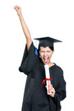 Graduating student gesturing fist with the diploma. That is the symbol of wisdom and knowledge, isolated on white stock images
