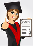 Graduating student girl in an academic gown Stock Image