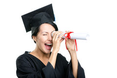 Graduating student keeps certificate. Like the telescope, isolated on white Stock Photos
