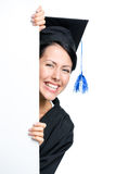Graduating student peeps out Stock Images