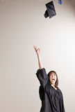 Graduating student throwing cap in air Royalty Free Stock Photos