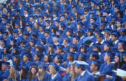 Graduating students in cap and gowns Royalty Free Stock Photos