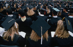Graduating students in cap and gowns Royalty Free Stock Images