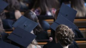 Graduating students feeling nervous before receiving higher education diplomas. Stock footage stock video footage
