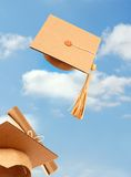 Graduating toss hats Stock Photo