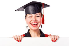 Graduating woman holding a display for text Stock Photos