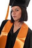 Graduating young. Portrait of young girl with gradution gown royalty free stock photography