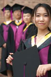 Graduation. Student in gown, the day they graduate from university Stock Images