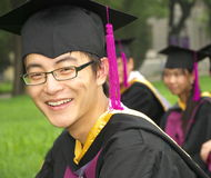 Graduation. Student in gown, the day they graduate from university Stock Photos