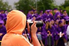 Graduation. Cameraman photographing students during graduation Stock Photos