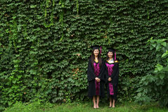 Graduation. Chinese woman students wear gown on graduation day Stock Photography