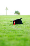 Graduation. Hat on Grass, commencement day Royalty Free Stock Images