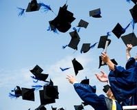 Graduation. High school graduation hats high Royalty Free Stock Photos