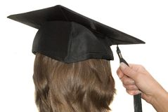 Graduation. Graduate with tassel in hand on graduation day Stock Photo
