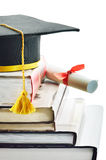 Graduation. Cap and diploma on top of stack of books Royalty Free Stock Photo
