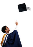 Graduation. Throwing the mortar in happiness Royalty Free Stock Images