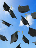 Graduation. A skyfull of mortar boards Stock Image