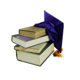Graduation. Mortar board with tassle used during ceremonies and Large book Stock Images