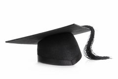 Graduation. Black graduation cap shot over white background Royalty Free Stock Photography