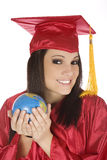 Caucasian student wearing a red graduation gown and holding globe Stock Photography