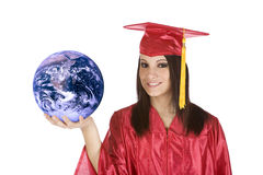 Caucasian teenager wearing a graduation gown holding the earth Stock Photo