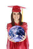 Caucasian teenager wearing a graduation gown holding the earth Royalty Free Stock Photo