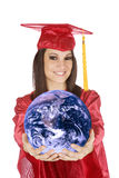 Caucasian teenager wearing a graduation gown holding the earth royalty free stock photos