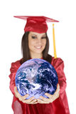 Caucasian teenager wearing a graduation gown holding the earth stock images