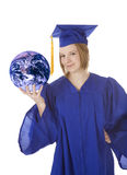 Caucasian teenager wearing a graduation gown holding the earth royalty free stock image