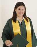 Graduation. A young lady graduates to a new level Royalty Free Stock Image