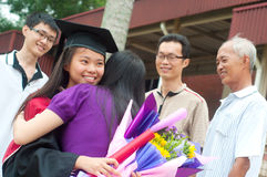 Graduation. Asian university student and family celebrating graduation stock image