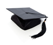 Graduation cap. Graduation mortar board / hat / cap with tassel on isolated white background Royalty Free Stock Images