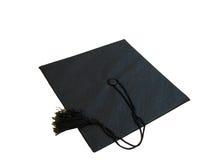 Graduation Cap. A black graduation cap with a tassel,over white Stock Photography