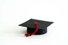Graduation cap. Graduation paper cap with a red tassel stock photo
