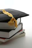Graduation cap. And textbooks royalty free stock image