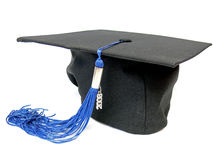 Graduation cap. With blue tassel detail isolated on the white background royalty free stock photos