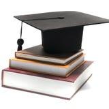 Graduation cap and book Royalty Free Stock Photo