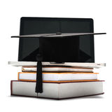 Graduation cap and book with laptop Royalty Free Stock Images